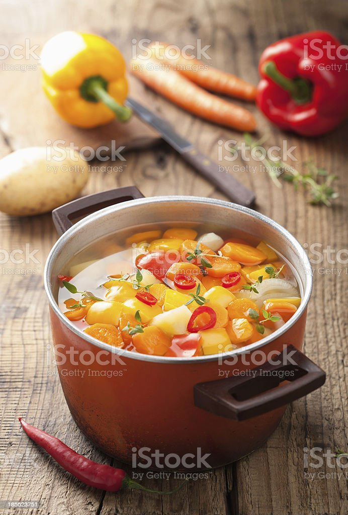 vegetable soup in red pot stock photo