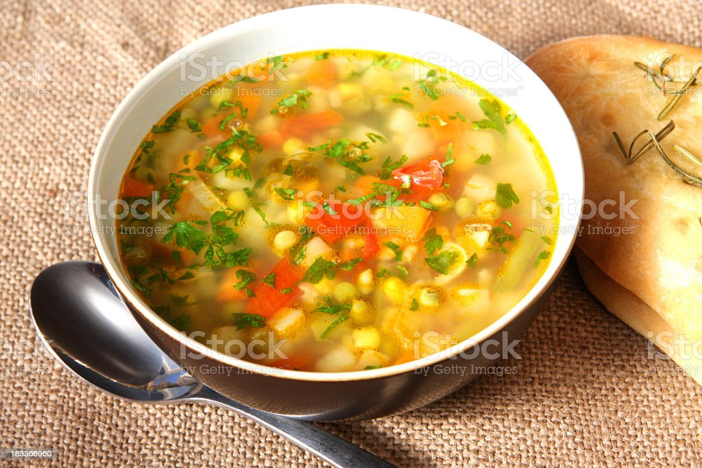 Vegetable soup in white porcelain bowl stock photo