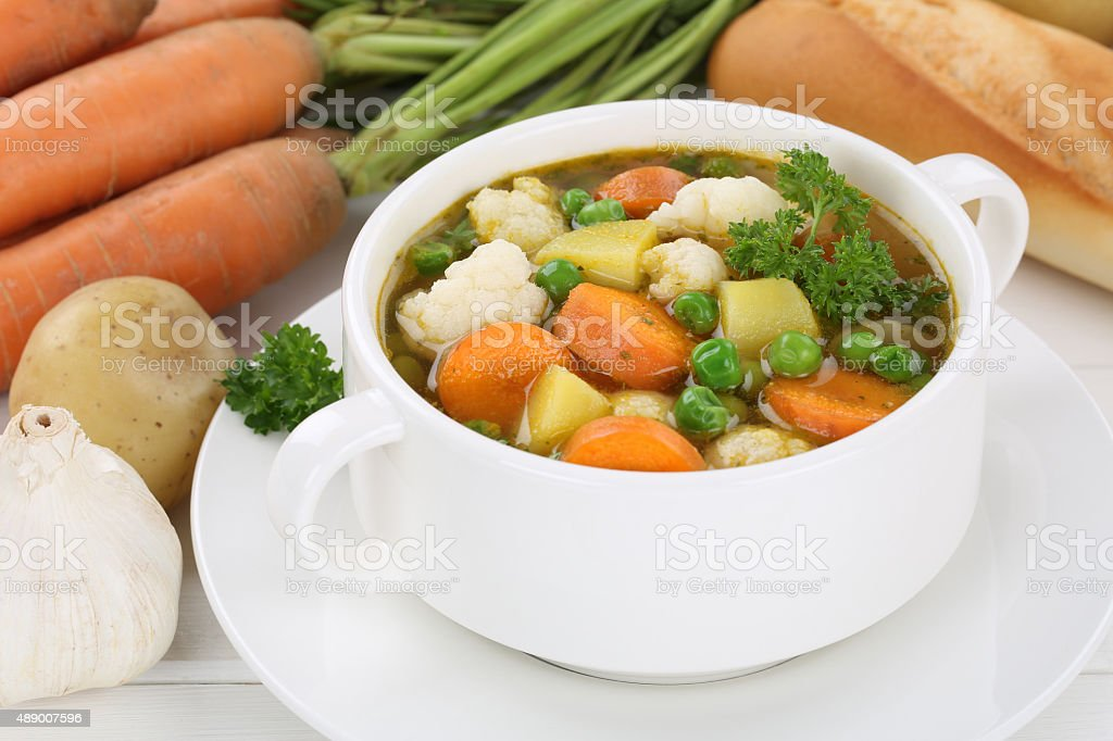 Vegetable soup meal with vegetables, potatoes, carrots stock photo