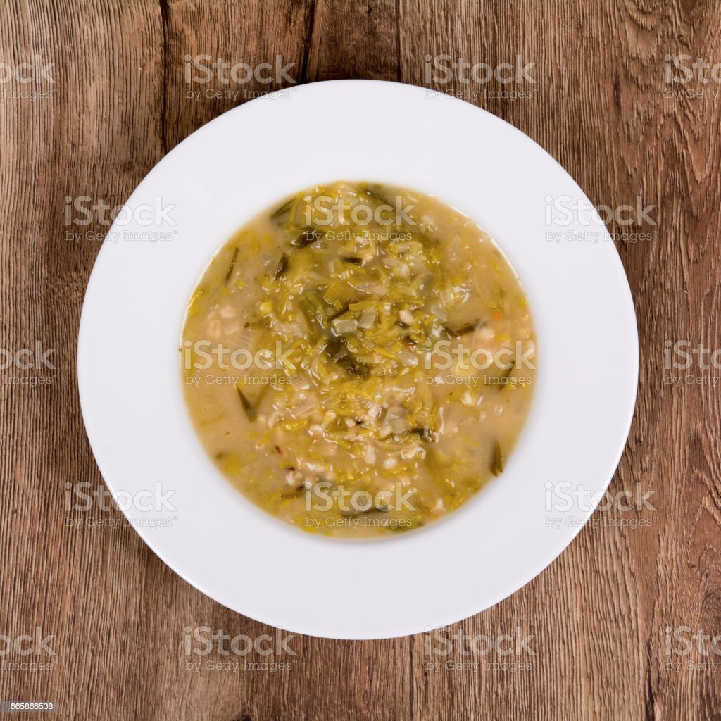 Vegetable soup on a wooden table stock photo