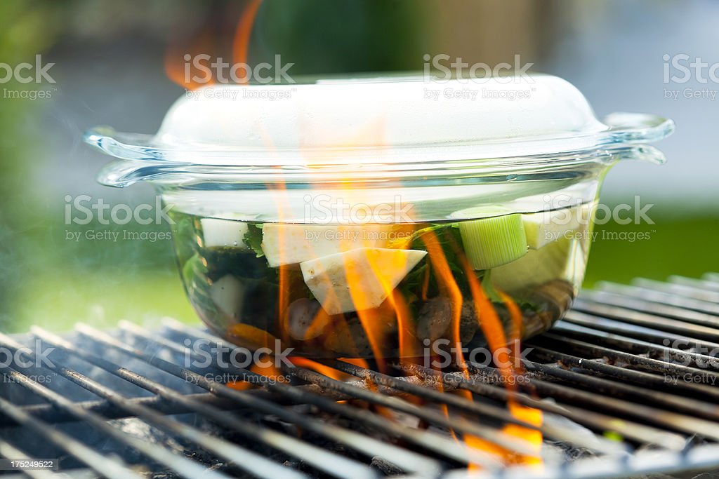 vegetable soup on fire outside royalty-free stock photo