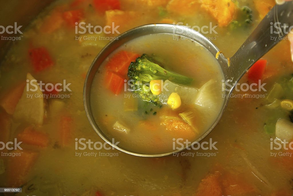 Vegetable soup on the metal ladle royalty-free stock photo