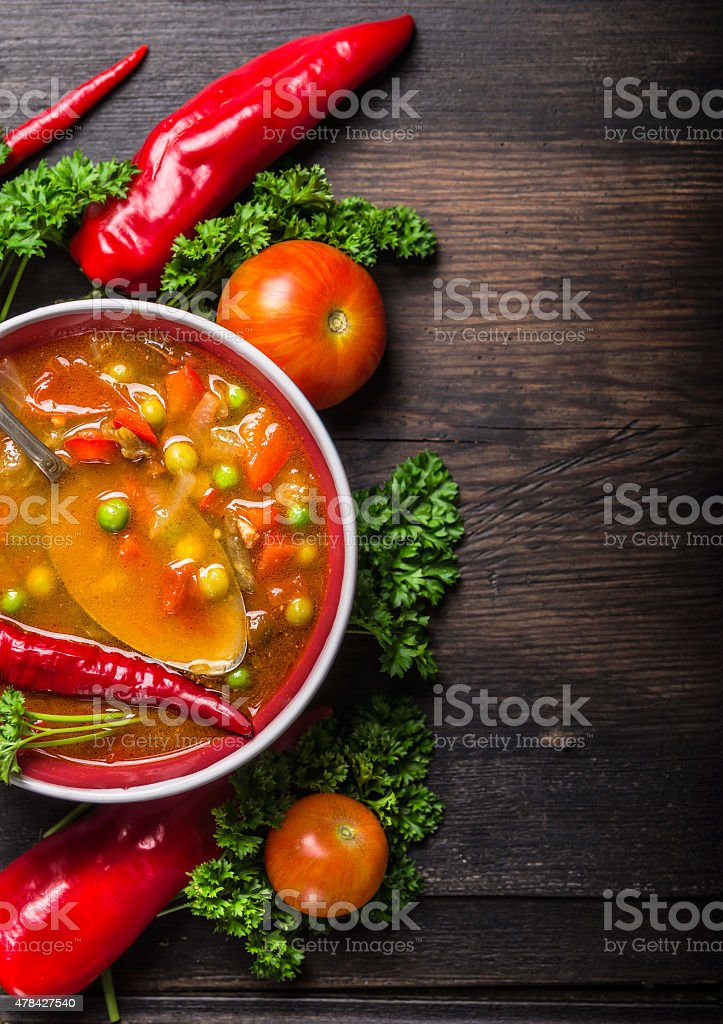 Vegetable soup , red pepper and tomatoes with green peas stock photo