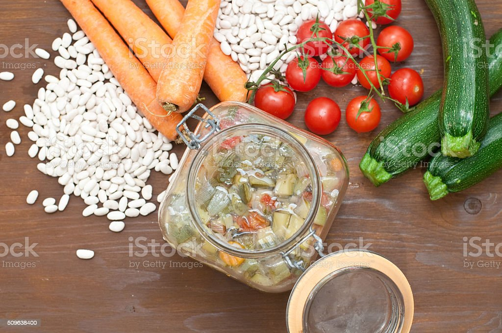 Vegetable soup, typical Italian soup with tomatoes, zucchini, po stock photo
