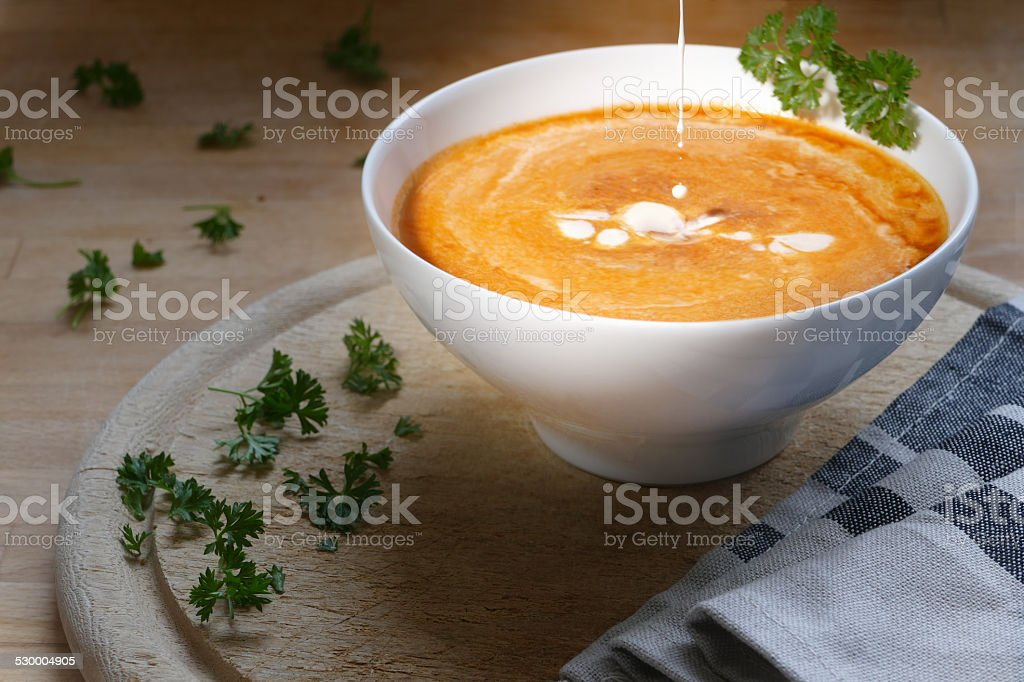 Vegetable soup with a little splash cream stock photo