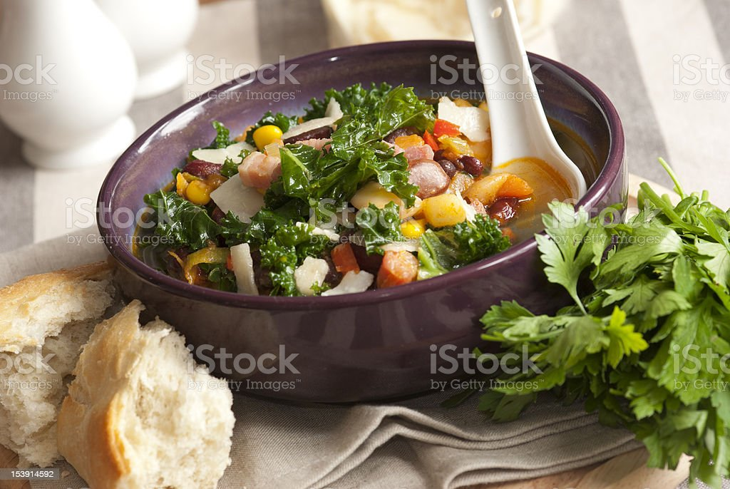 Vegetable soup with a side of French bread stock photo