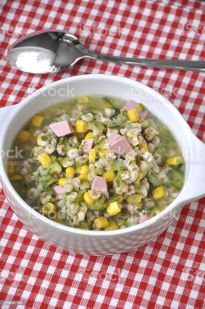 Vegetable soup with barley grains stock photo