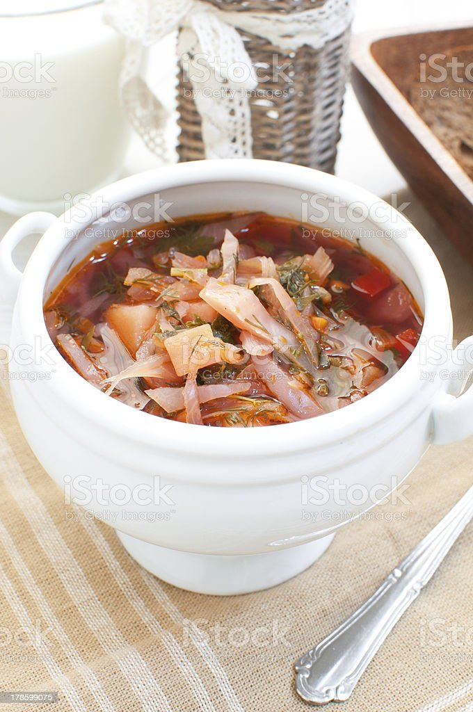 Vegetable soup with beet, potato and cabbage stock photo