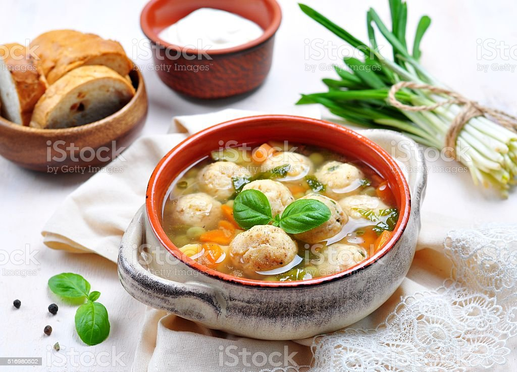 Vegetable soup with fish balls and wild garlic stock photo