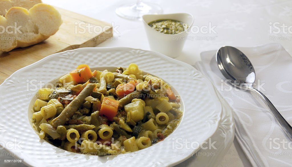 Vegetable soup with pesto stock photo