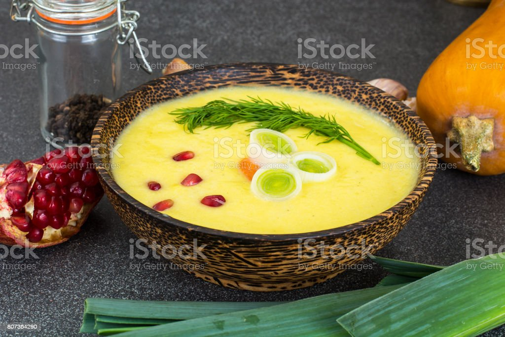 Vegetable soup with pumpkin and pomegranate stock photo
