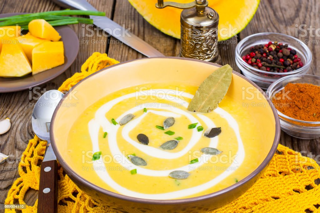 Vegetable soup with pumpkin seeds stock photo