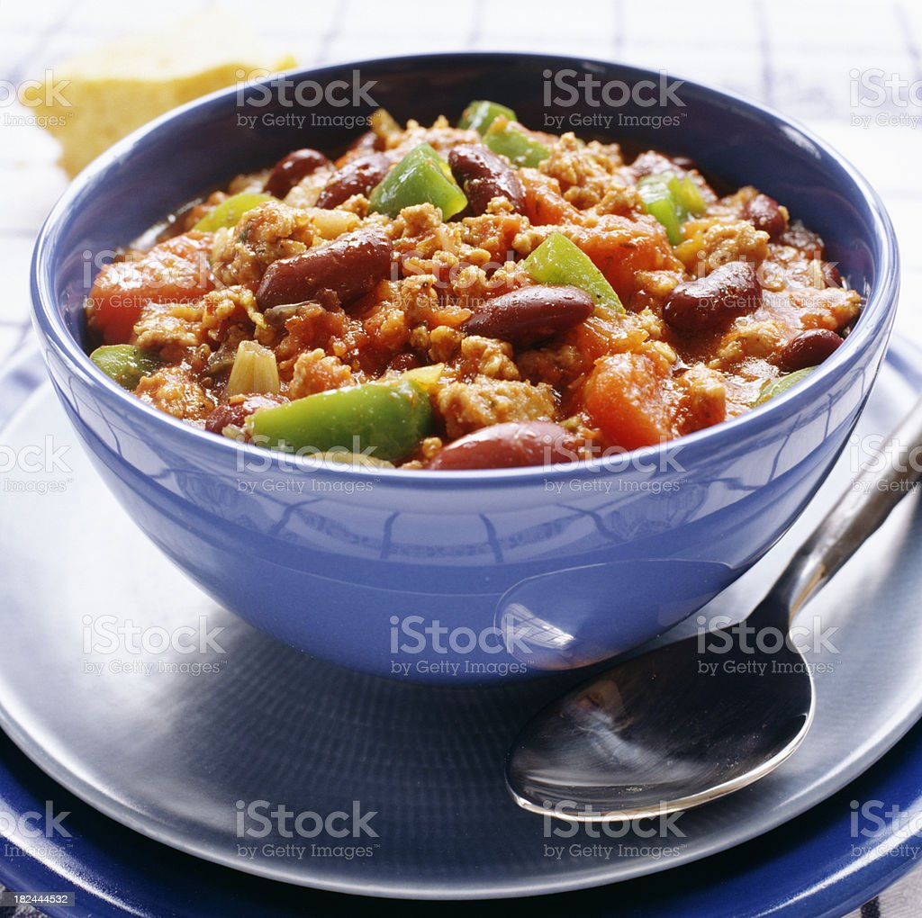 Vegetable stew in blue bowl stock photo