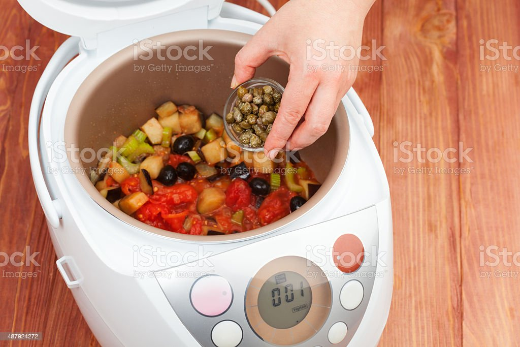 vegetable stew in multicooker stock photo