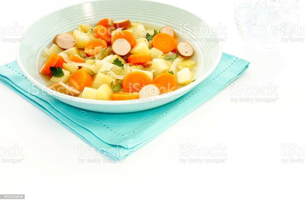 Vegetable Stew with Sausage in Blue Soup Bowl stock photo