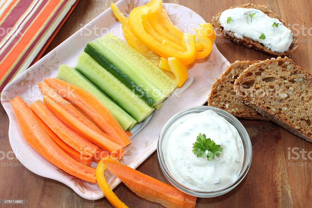 vegetable sticks with sour cream stock photo