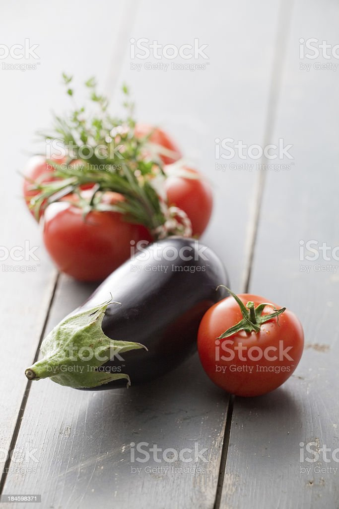 Vegetable Stills: Eggplant and Tomatoes royalty-free stock photo