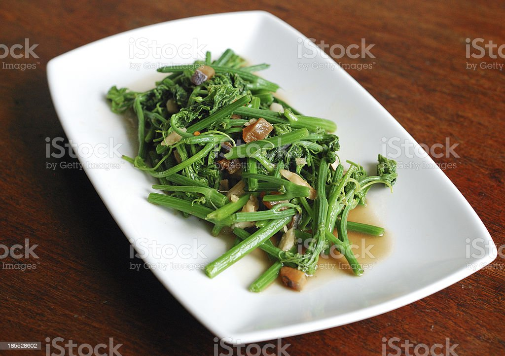 vegetable with salted fish stock photo