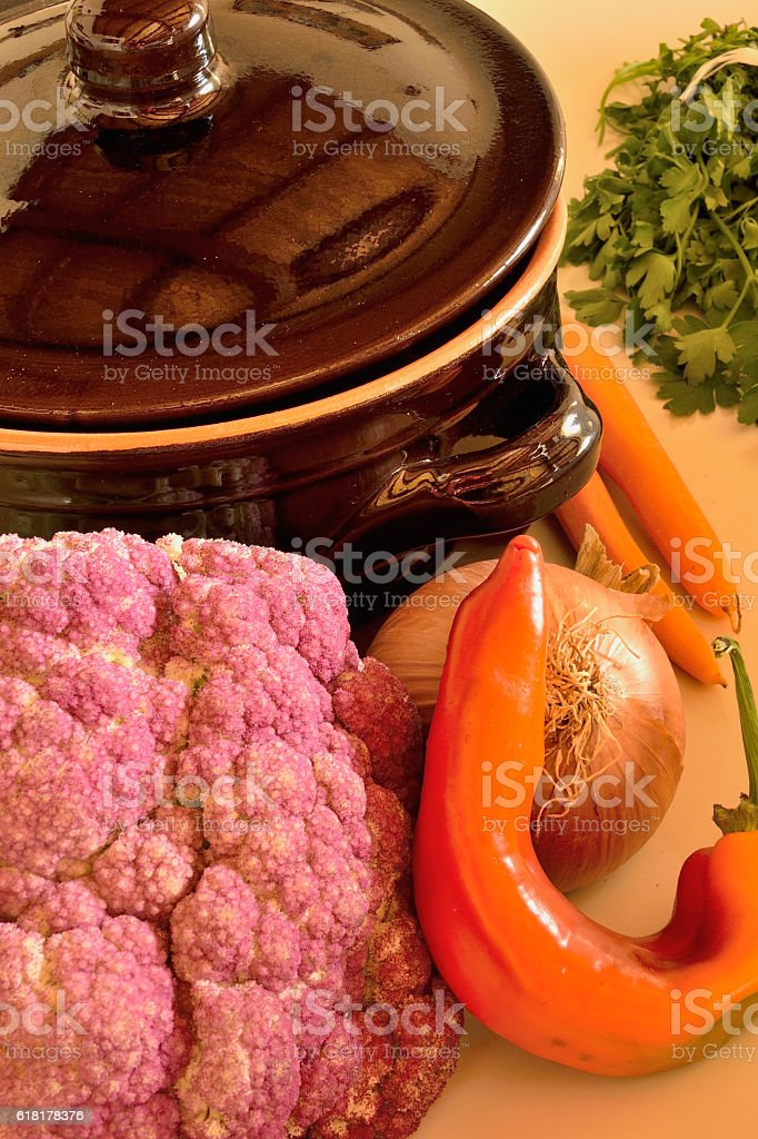 Vegetables and ceramic pot stock photo