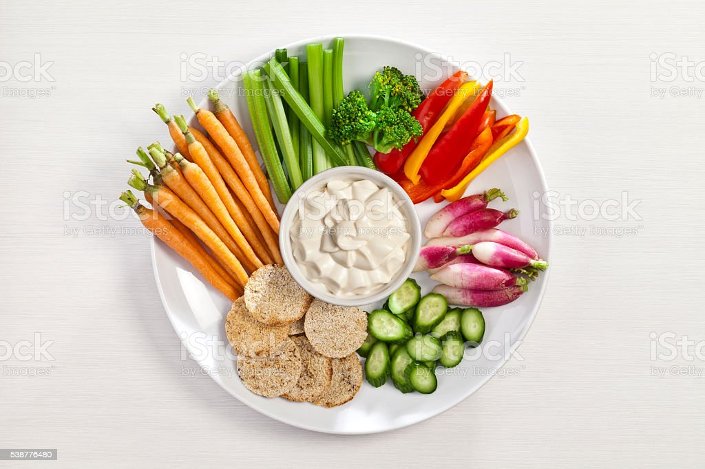 Vegetables and dip plate stock photo