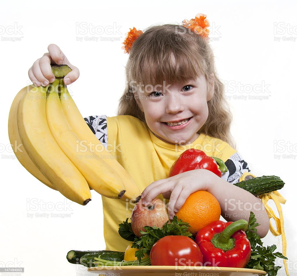 Vegetables and fruit it are a healthy food of children. royalty-free stock photo