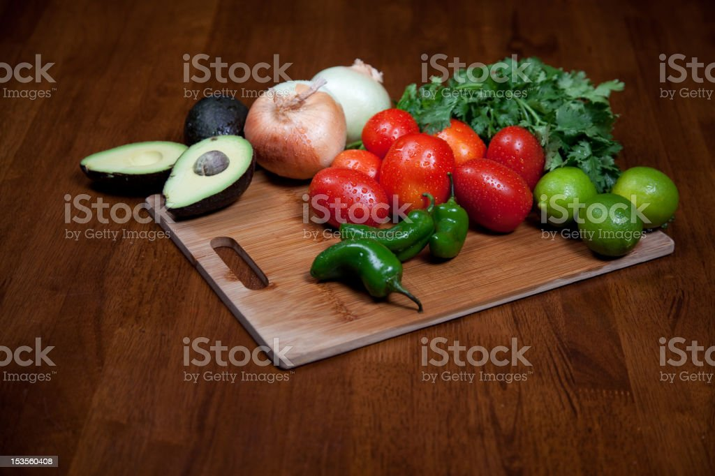 Vegetables and Fruit on Cutting Board stock photo