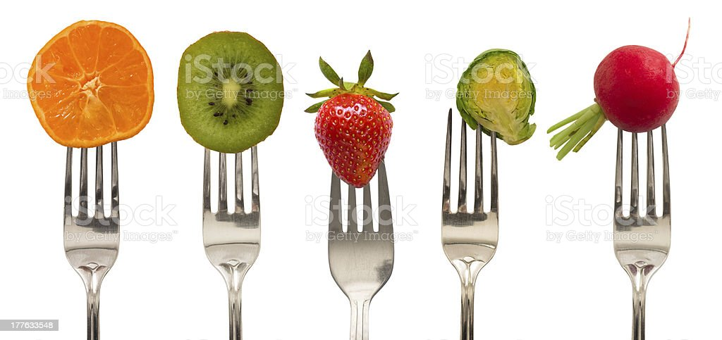 vegetables and fruits on the forks stock photo