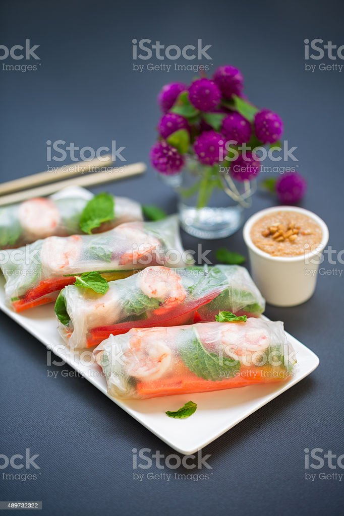 Vegetables and shrimps spring rolls with peanut sauce stock photo