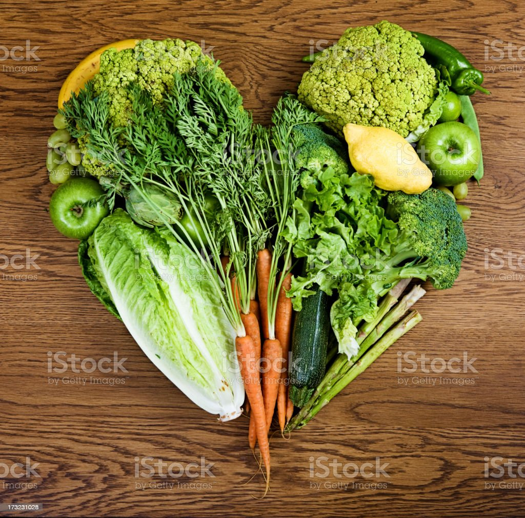 Vegetables arranged in a heart stock photo