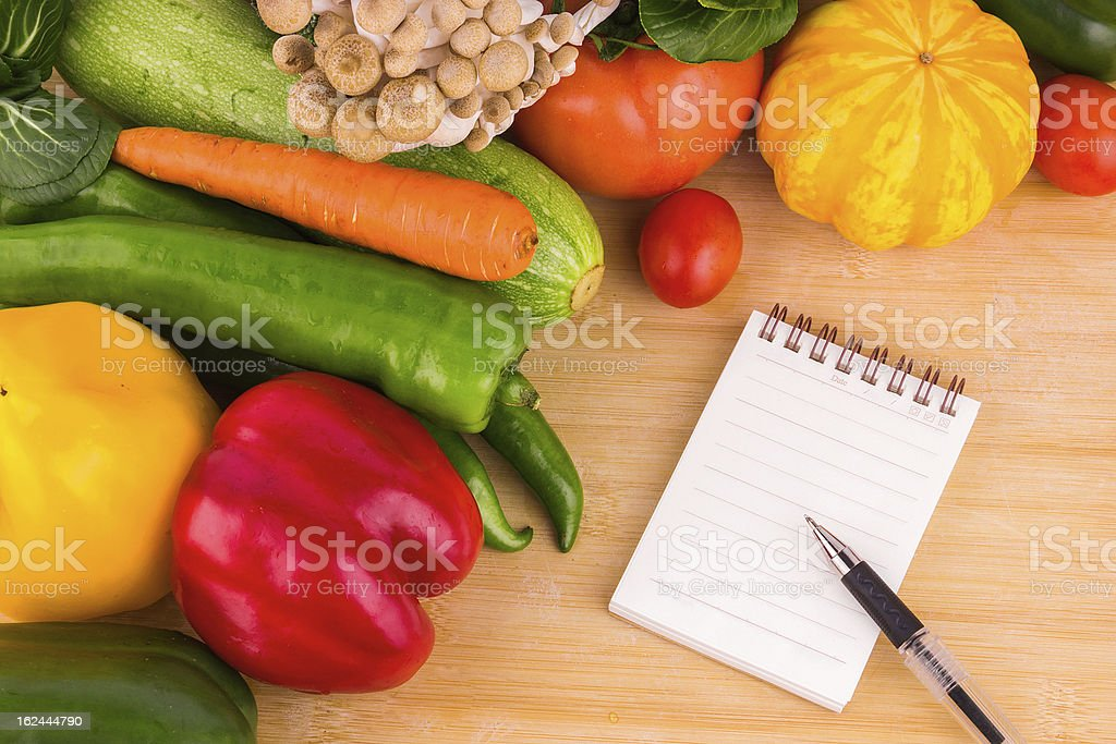 Vegetables background and blank note royalty-free stock photo