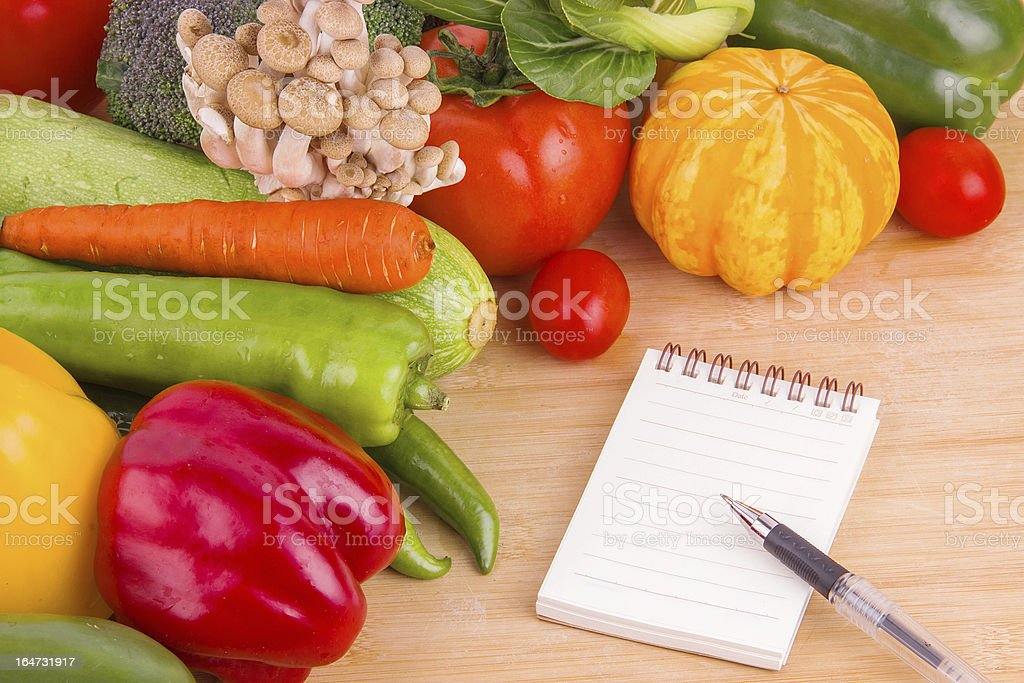 Vegetables background and blank notebook stock photo