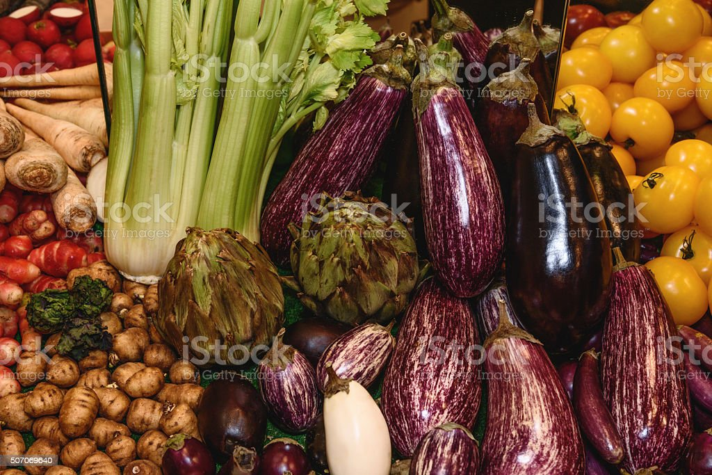 Vegetables, edible roots, tubers. Eggplant, tomatoes, artichokes, fennel, parsley root stock photo