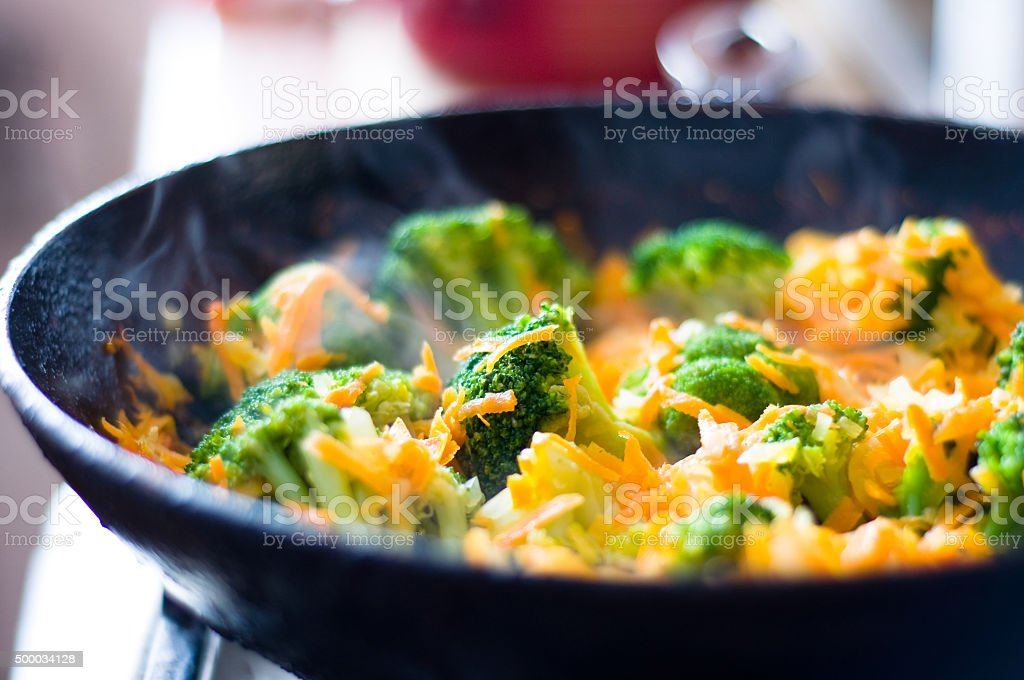 vegetables fried in a pan stock photo