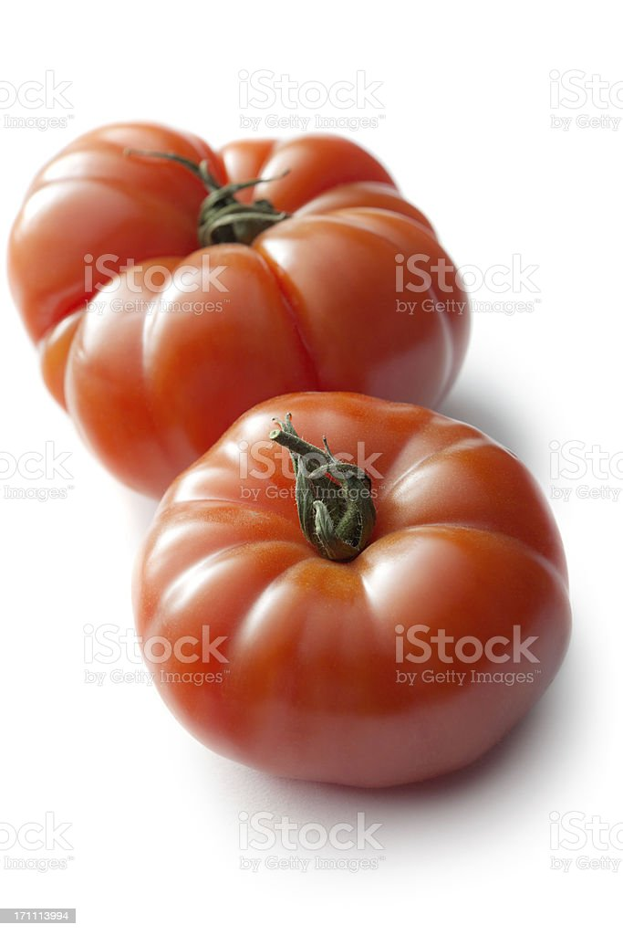 Vegetables: Heirloom Tomato Isolated on White Background stock photo