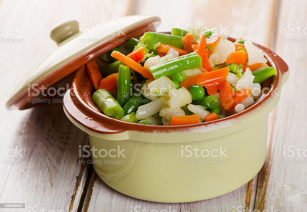 Vegetables in a clay  bowl stock photo