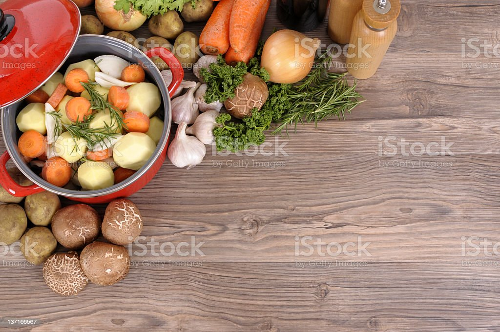 Vegetables in a pot that have been cut and peeled stock photo