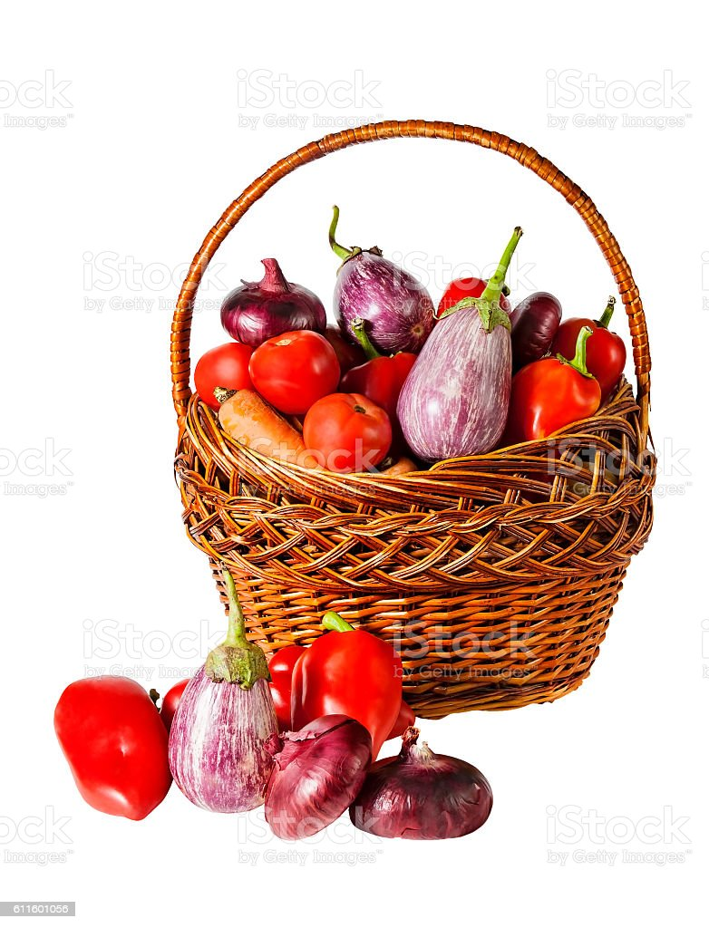 Vegetables in basket isolated on white background stock photo