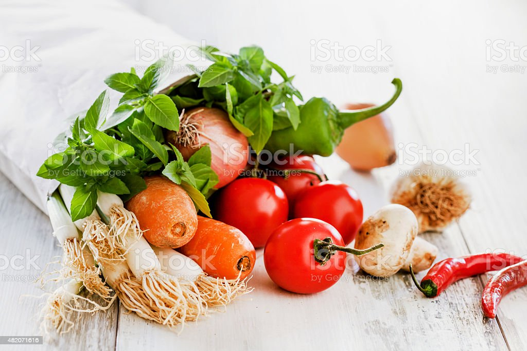 Vegetables in paper bag stock photo