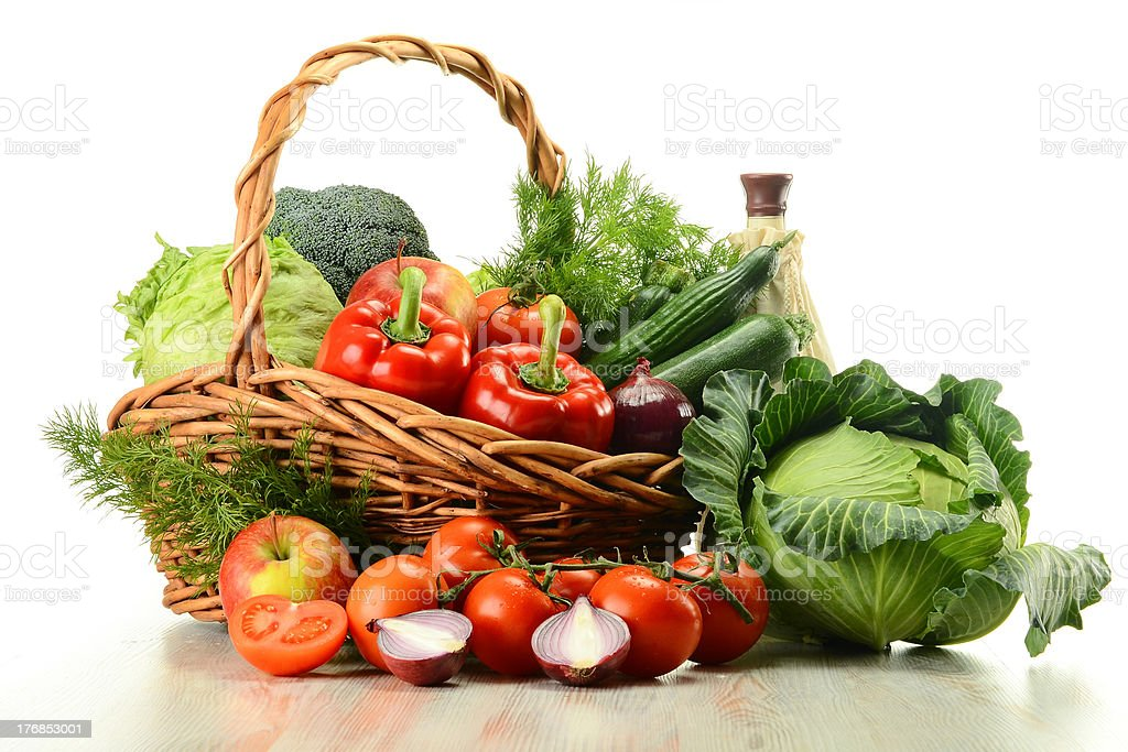 Vegetables in wicker basket isolated on white royalty-free stock photo