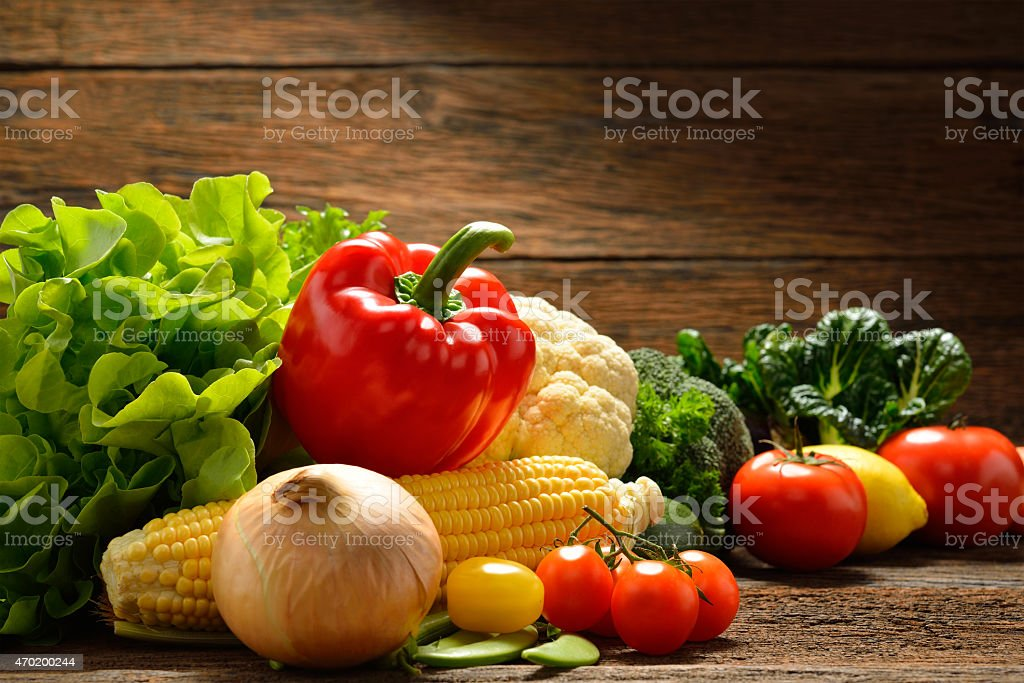 Vegetables isolated on wooden background stock photo