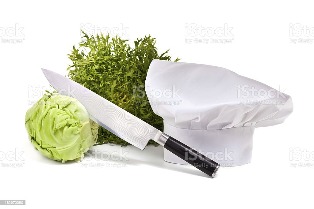 Vegetables, knife and chef's hat royalty-free stock photo