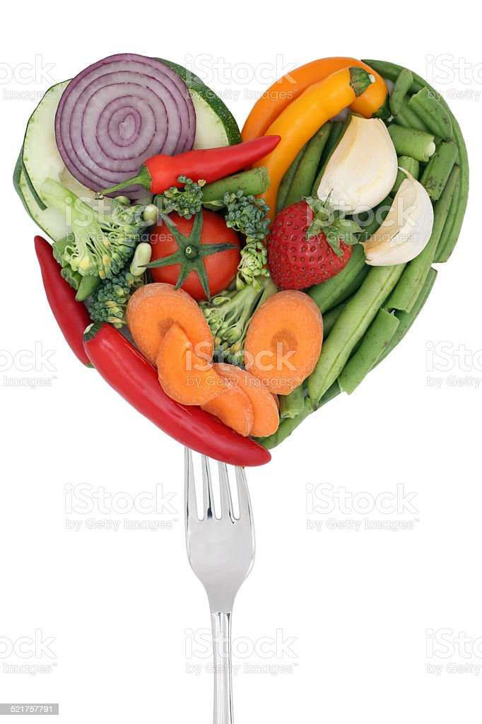 Vegetables love heart on a fork stock photo