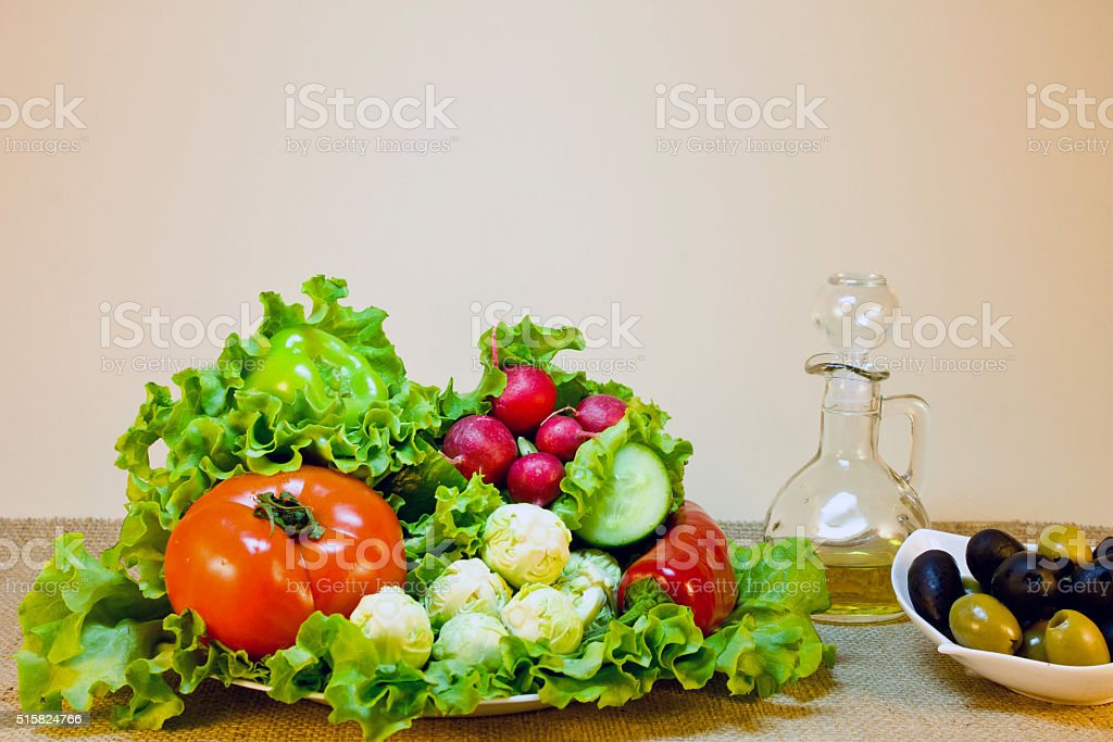 vegetables on a platter and olives in a saucer stock photo
