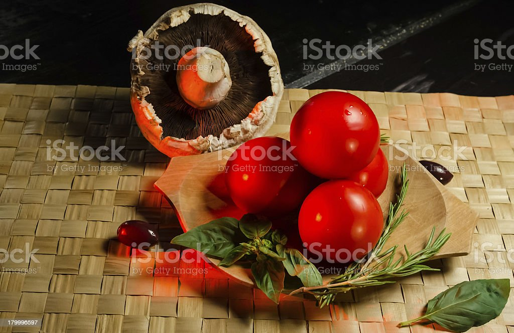 Vegetables on a wooden plate royalty-free stock photo