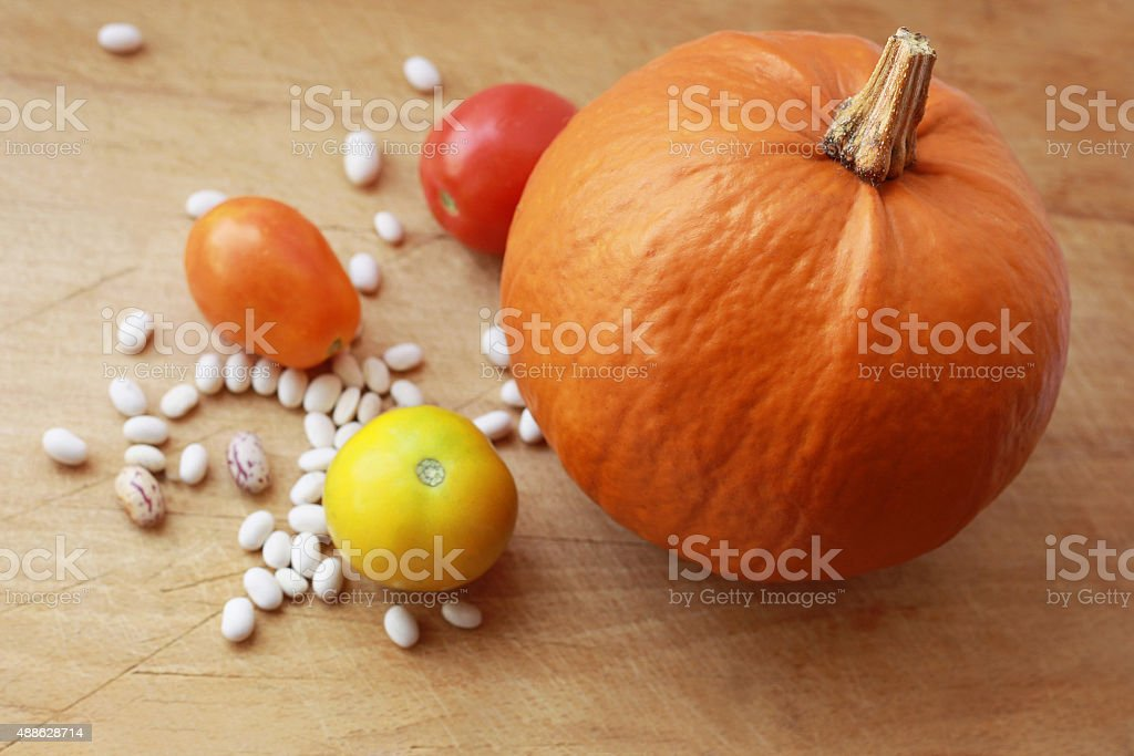 Vegetables on a wooden surface stock photo