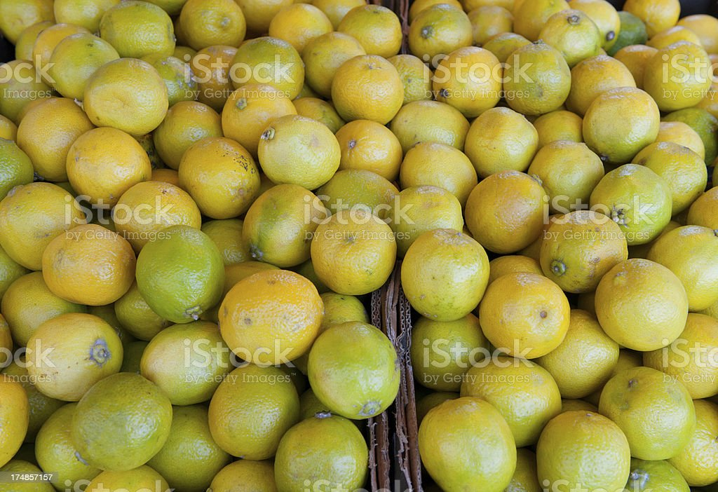 Vegetables on market stall: key limes royalty-free stock photo