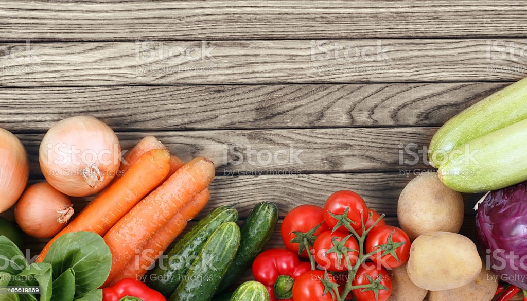 Vegetables on wood background with space for text. Organic food. royalty-free stock photo