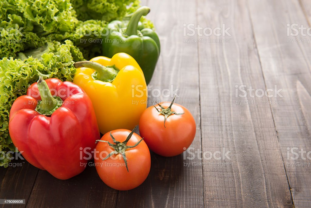 Vegetables on wooden backgorund, Organic food background. stock photo