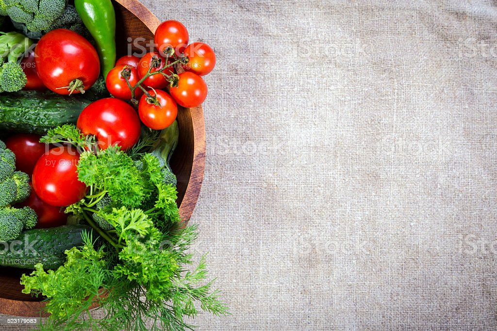 vegetables on wooden plate stock photo