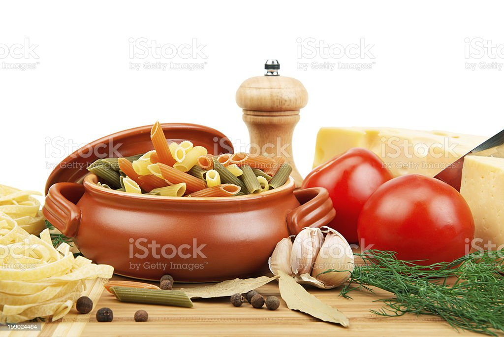 vegetables, pasta, spices and kitchen utensils royalty-free stock photo